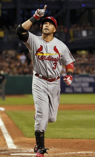 Oct 6, 2013; Pittsburgh, PA, USA; St. Louis Cardinals right fielder Carlos Beltran (3) reacts after hitting a home run against the Pittsburgh Pirates in the 8th inning in game three of the National League divisional series playoff baseball game at PNC Park. Mandatory Credit: Charles LeClaire-USA TODAY Sports