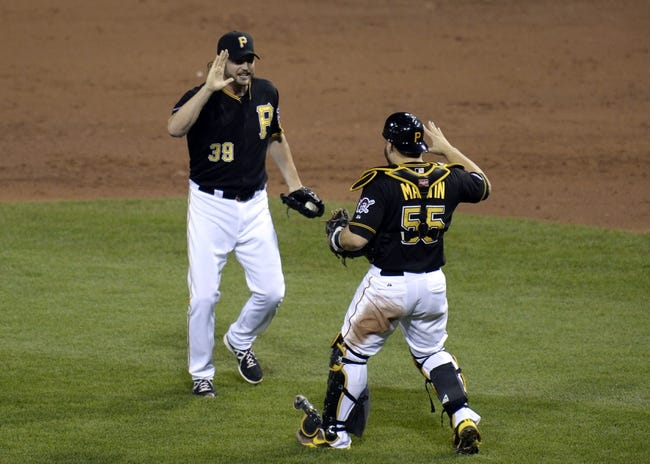 Oct 6, 2013; Pittsburgh, PA, USA; Pittsburgh Pirates relief pitcher Jason Grilli (39) celebrates with catcher Russell Martin (55) after game three of the National League divisional series playoff baseball game against the St. Louis Cardinals at PNC Park. Mandatory Credit: H.Darr Beiser-USA TODAY Sports
