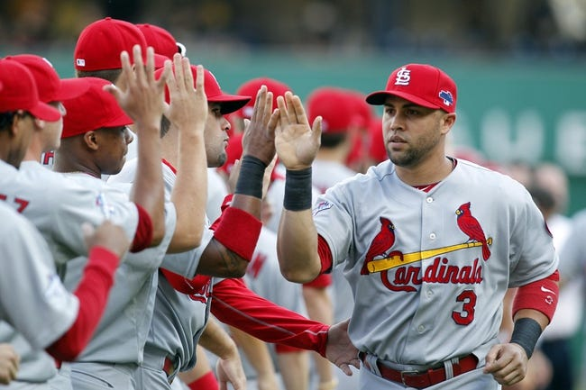Oct 6, 2013; Pittsburgh, PA, USA; St. Louis Cardinals right fielder Carlos Beltran (3) greets teammates during player introductions before playing the Pittsburgh Pirates in game three of the National League divisional series playoff baseball game at PNC Park. Pittsburgh won 5-3. Mandatory Credit: Charles LeClaire-USA TODAY Sports
