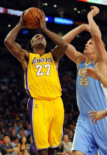 Oct 6, 2013; Los Angeles, CA, USA; Los Angeles Lakers center Jordan Hill (27) works against Denver Nuggets center Timofey Mozgov (25) during the first half at Staples Center. Mandatory Credit: Christopher Hanewinckel-USA TODAY Sports