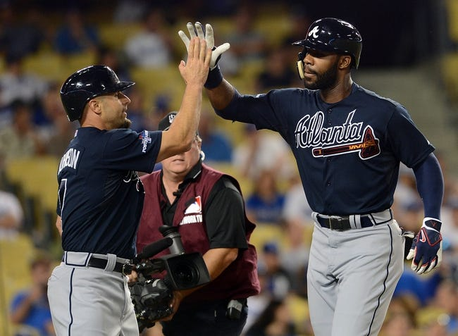 October 6, 2013; Los Angeles, CA, USA; Atlanta Braves right fielder Jason Heyward (22) is congratulated by right fielder Reed Johnson (7) after hitting a two run home run in the ninth inning against the Los Angeles Dodgers in game three of the National League divisional series playoff baseball game at Dodger Stadium. Mandatory Credit: Jayne Kamin-Oncea-USA TODAY Sports