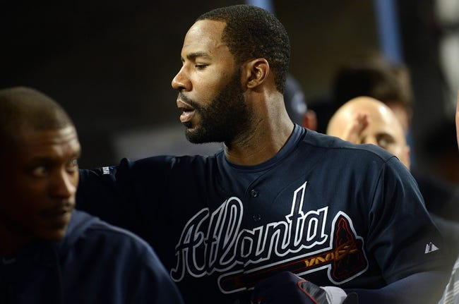 October 6, 2013; Los Angeles, CA, USA; Atlanta Braves right fielder Jason Heyward (22) is congratulated after hitting a two run home run in the ninth inning against the Los Angeles Dodgers in game three of the National League divisional series playoff baseball game at Dodger Stadium. Mandatory Credit: Jayne Kamin-Oncea-USA TODAY Sports