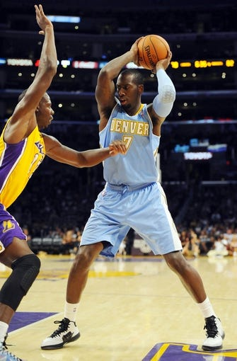 Oct 6, 2013; Los Angeles, CA, USA; Denver Nuggets forward J.J. Hickson (7) during the second half against the Los Angeles Lakers at Staples Center. The Nuggets won 97-88. Mandatory Credit: Christopher Hanewinckel-USA TODAY Sports