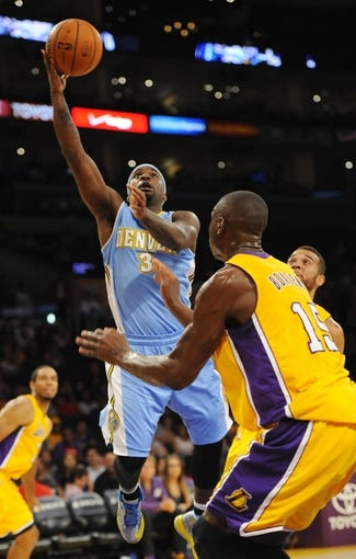 Oct 6, 2013; Los Angeles, CA, USA; Denver Nuggets guard Ty Lawson (3) shoots a layup during the second half against the Los Angeles Lakers at Staples Center. The Nuggets won 97-88. Mandatory Credit: Christopher Hanewinckel-USA TODAY Sports