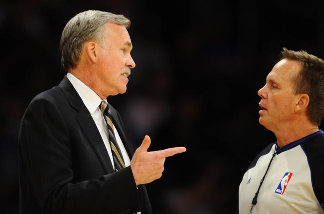 Oct 6, 2013; Los Angeles, CA, USA; Los Angeles Lakers head coach Mike D'Antoni questions a call by the referee during the second half against the Denver Nuggets at Staples Center. The Nuggets won 97-88. Mandatory Credit: Christopher Hanewinckel-USA TODAY Sports