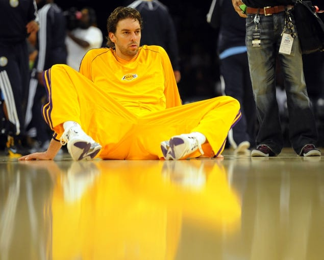 Oct 6, 2013; Los Angeles, CA, USA; Los Angeles Lakers forward Pau Gasol (16) stretches prior to the game against the Denver Nuggets at Staples Center. Mandatory Credit: Christopher Hanewinckel-USA TODAY Sports