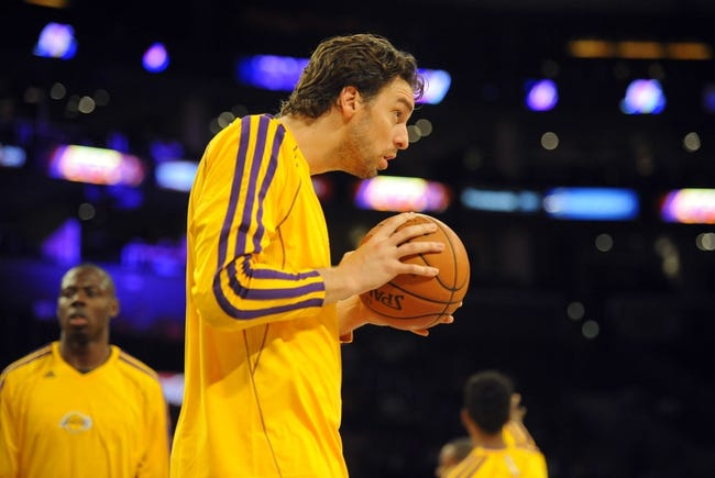 Oct 6, 2013; Los Angeles, CA, USA; Los Angeles Lakers forward Pau Gasol (16) during warmups prior to the game against the Denver Nuggets at Staples Center. Mandatory Credit: Christopher Hanewinckel-USA TODAY Sports