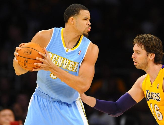 Oct 6, 2013; Los Angeles, CA, USA; Denver Nuggets center JaVale McGee (34) works against Los Angeles Lakers forward Pau Gasol (16) during the first half at Staples Center. Mandatory Credit: Christopher Hanewinckel-USA TODAY Sports