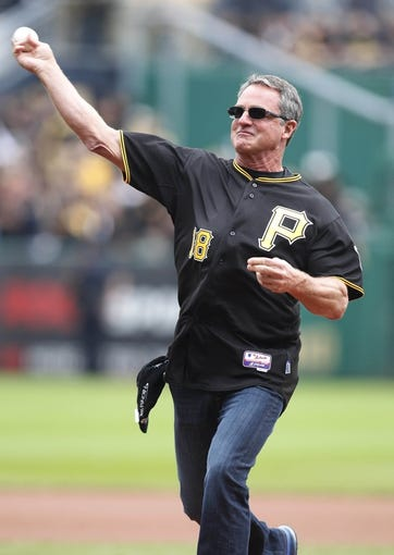 Oct 7, 2013; Pittsburgh, PA, USA; Pittsburgh Pirates former center fielder Andy VanSlyke throws out a ceremonial first pitch before the Pirates host the St. Louis Cardinals in game four of the National League divisional series at PNC Park. The St. Louis Cardinals won 2-1. Mandatory Credit: Charles LeClaire-USA TODAY Sports