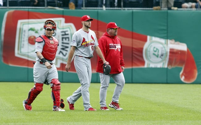 Oct 7, 2013; Pittsburgh, PA, USA; St. Louis Cardinals catcher Yadier Molina (left) and starting pitcher Michael Wacha (52) and pitching coach Derek Lilliquist (right) make their way in from the bullpen to play the Pittsburgh Pirates in game four of the National League divisional series at PNC Park. The St. Louis Cardinals won 2-1. Mandatory Credit: Charles LeClaire-USA TODAY Sports