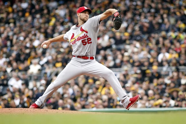 Oct 7, 2013; Pittsburgh, PA, USA; St. Louis Cardinals starting pitcher Michael Wacha (52) delivers a pitch against the Pittsburgh Pirates during the second inning in game four of the National League divisional series at PNC Park. The Cards won 2-1. Mandatory Credit: Charles LeClaire-USA TODAY Sports