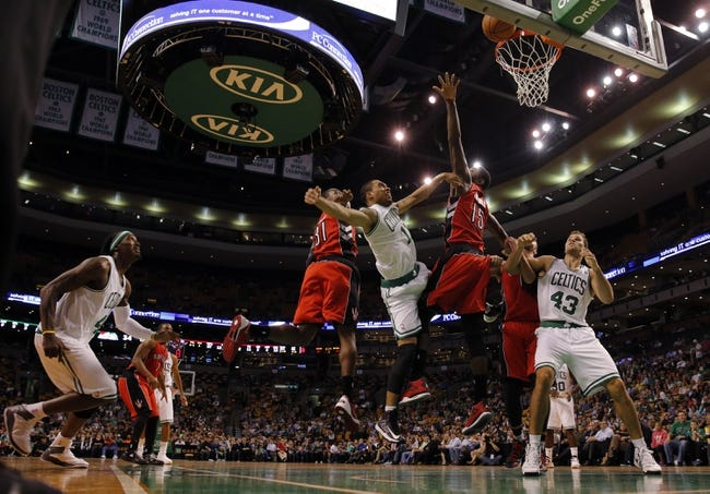 Oct 7, 2013; Boston, MA, USA; Boston Celtics guard Courtney Lee (11) shoots against Toronto Raptors power forward Amir Johnson (15) in the first half at TD Garden. Mandatory Credit: David Butler II-USA TODAY Sports