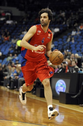 Oct 7, 2013; Minneapolis, MN, USA;  CSKA Moscow guard Milos Teodosic (4) brings the ball up court in the first quarter against the Minnesota Timberwolves at Target Center. Mandatory Credit: Marilyn Indahl-USA TODAY Sports