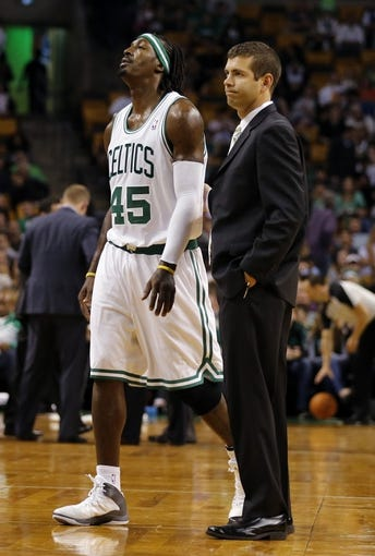 Oct 7, 2013; Boston, MA, USA; Boston Celtics forward Gerald Wallace (45) and head coach Brad Stevens mid-court during a break in the action against the Toronto Raptors in the second half at TD Garden. The Raptors defeated the Celtics 97-89. Mandatory Credit: David Butler II-USA TODAY Sports
