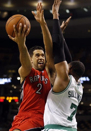 Oct 7, 2013; Boston, MA, USA; Toronto Raptors small forward Landry Fields (2) drives the ball against Boston Celtics forward Jared Sullinger (7) in the second half at TD Garden. The Raptors defeated the Celtics 97-89. Mandatory Credit: David Butler II-USA TODAY Sports