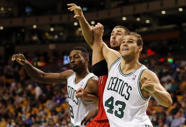 Oct 7, 2013; Boston, MA, USA; Boston Celtics forward Kris Humphries (43) and forward Jeff Green (8) work for the rebound against Toronto Raptors center Jonas Valanciunas (17) in the second half at TD Garden. The Raptors defeated the Celtics 97-89. Mandatory Credit: David Butler II-USA TODAY Sports