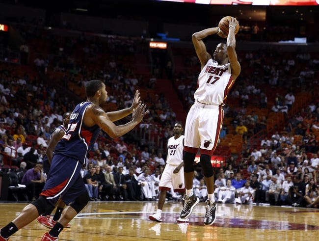 Oct 7, 2013; Miami, FL, USA;  Miami Heat small forward Eric Griffin (17) takes a shot as Atlanta Hawks power forward Mike Scott (32) defends in the second half at American Airlines Arena. Mandatory Credit: Robert Mayer-USA TODAY Sports