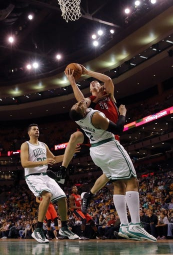 Oct 7, 2013; Boston, MA, USA; Toronto Raptors power forward Tyler Hansbrough (50) drives the ball over Boston Celtics forward Jared Sullinger (7) in the second half at TD Garden. The Raptors defeated the Celtics 97-89. Mandatory Credit: David Butler II-USA TODAY Sports