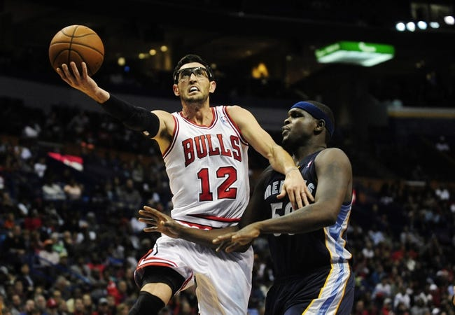 Oct 7, 2013; St. Louis, MO, USA; Chicago Bulls shooting guard Kirk Hinrich (12) is fouled by Memphis Grizzlies power forward Zach Randolph (50) during the second quarter at Scottrade Center. Chicago defeated Memphis 106-87. Mandatory Credit: Jeff Curry-USA TODAY Sports