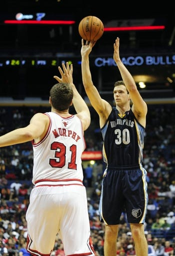 Oct 7, 2013; St. Louis, MO, USA; Memphis Grizzlies power forward Jon Leuer (30) shoots as Chicago Bulls power forward Erik Murphy (31) defends during the third quarter at Scottrade Center. Chicago defeated Memphis 106-87. Mandatory Credit: Jeff Curry-USA TODAY Sports