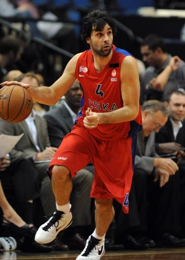 Oct 7, 2013; Minneapolis, MN, USA;  CSKA Moscow guard Milos Teodosic (4) brings the ball up court in the first half against the Minnesota Timberwolves at Target Center.  CSKA Moscow defeated the Minnesota Timberwolves 108-106 in overtime.  Mandatory Credit: Marilyn Indahl-USA TODAY Sports
