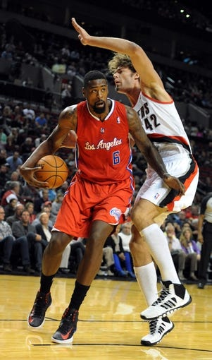 Oct 7, 2013; Portland, OR, USA; Los Angeles Clippers center DeAndre Jordan (6) drives to the basket on Portland Trail Blazers center Robin Lopez (42) during the first quarter at Moda Center. Mandatory Credit: Steve Dykes-USA TODAY Sports
