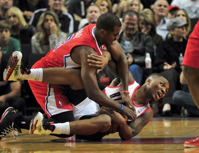 Oct 7, 2013; Portland, OR, USA; Los Angeles Clippers point guard Chris Paul (3) and Portland Trail Blazers point guard Damian Lillard (0) scramble for a loose ball during the first quarter of the game at Moda Center. Mandatory Credit: Steve Dykes-USA TODAY Sports