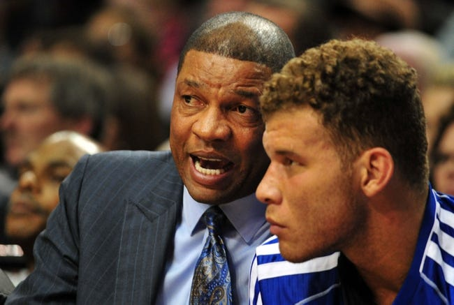 Oct 7, 2013; Portland, OR, USA; Los Angeles Clippers head coach Doc Rivers speaks with power forward Blake Griffin (32) on the bench during the second quarter of the game against the Portland Trail Blazers at Moda Center. Mandatory Credit: Steve Dykes-USA TODAY Sports