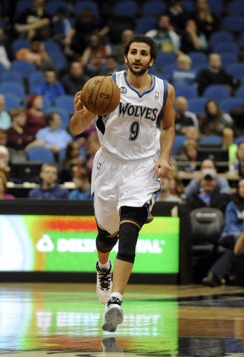Oct 7, 2013; Minneapolis, MN, USA;  Minnesota Timberwolves guard Ricky Rubio (9) brings the ball up court in the third quarter against the CSKA Moscow at Target Center.  CSKA Moscow defeated the Minnesota Timberwolves 108-106 in overtime.  Mandatory Credit: Marilyn Indahl-USA TODAY Sports