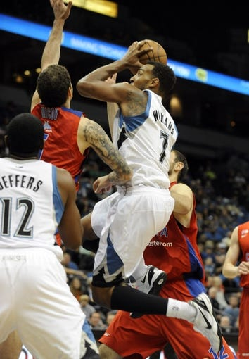 Oct 7, 2013; Minneapolis, MN, USA;  Minnesota Timberwolves forward Derrick Williams (7) takes a shot over CSKA Moscow forward Vladimir Micov (5) in the third quarter at Target Center.  CSKA Moscow defeated the Minnesota Timberwolves 108-106 in overtime.  Mandatory Credit: Marilyn Indahl-USA TODAY Sports
