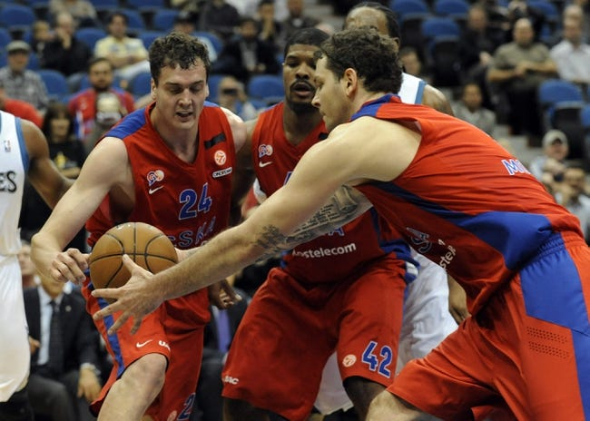Oct 7, 2013; Minneapolis, MN, USA;  CSKA Moscow center Alexander Kaun (24), forward Kyle Hines (42) and forward Vladimir Micov (5) reach for a rebound in overtime at Target Center.  CSKA Moscow defeated the Minnesota Timberwolves 108-106 in overtime.  Mandatory Credit: Marilyn Indahl-USA TODAY Sports