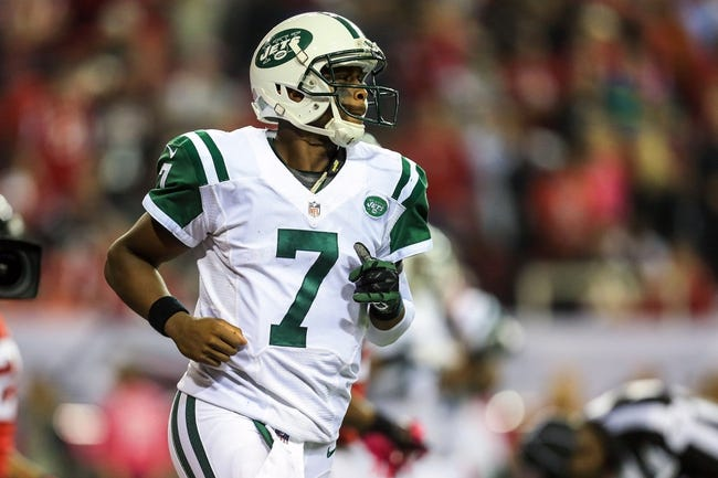 Oct 7, 2013; Atlanta, GA, USA; New York Jets quarterback Geno Smith (7) runs back to the sideline after a touchdown in the second half against the Atlanta Falcons at the Georgia Dome. The Jets won 30-28. Mandatory Credit: Daniel Shirey-USA TODAY Sports