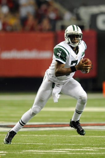 Oct 7, 2013; Atlanta, GA, USA; New York Jets quarterback Geno Smith (7) runs with the ball against the Atlanta Falcons during the second half at the Georgia Dome. The Jets defeated the Falcons 30-28. Mandatory Credit: Dale Zanine-USA TODAY Sports