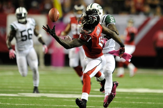 Oct 7, 2013; Atlanta, GA, USA; Atlanta Falcons wide receiver Julio Jones (11) makes a one handed catch behind New York Jets cornerback Antonio Cromartie (31) during the second half at the Georgia Dome. The Jets defeated the Falcons 30-28. Mandatory Credit: Dale Zanine-USA TODAY Sports