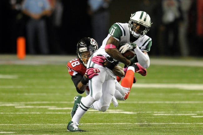 Oct 7, 2013; Atlanta, GA, USA; Atlanta Falcons safety Thomas DeCoud (28) tackles New York Jets wide receiver Jeremy Kerley (11) after a catch on the last drive during the second half at the Georgia Dome. The Jets defeated the Falcons 30-28. Mandatory Credit: Dale Zanine-USA TODAY Sports