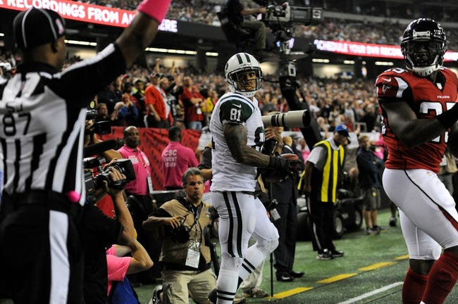 Oct 7, 2013; Atlanta, GA, USA; New York Jets tight end Kellen Winslow (81) reacts after catching a touchdown pass behind Atlanta Falcons safety William Moore (25) during the second half at the Georgia Dome. The Jets defeated the Falcons 30-28. Mandatory Credit: Dale Zanine-USA TODAY Sports