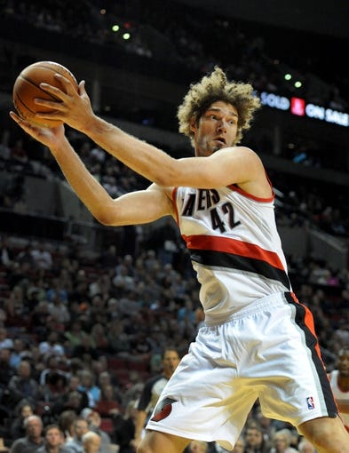 Oct 7, 2013; Portland, OR, USA; Portland Trail Blazers center Robin Lopez (42) grabs a rebound during the third quarter of the game against the Los Angeles Clippers at Moda Center. Mandatory Credit: Steve Dykes-USA TODAY Sports