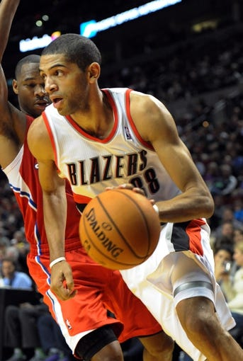 Oct 7, 2013; Portland, OR, USA; Portland Trail Blazers small forward Nicolas Batum (88) drives to the basket on Los Angeles Clippers shooting guard Willie Green (34) during the third quarter of the game at Moda Center. Mandatory Credit: Steve Dykes-USA TODAY Sports