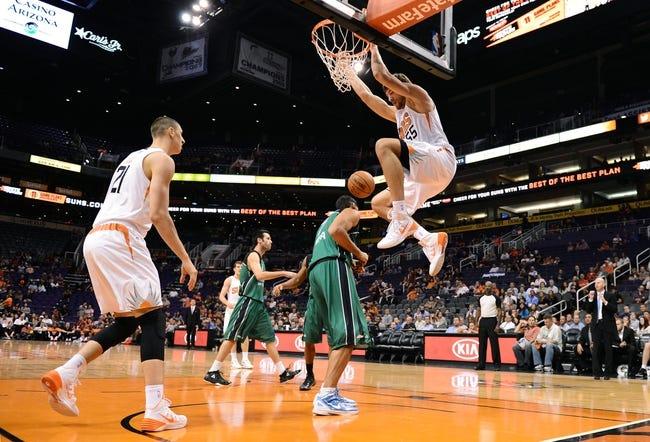 Oct 7, 2013; Phoenix, AZ, USA; Phoenix Suns center Viacheslav Kravtsov (55)  dunks the ball over Haifa center Alex Chubrevich (7) in the second half at US Airways Center. The Suns defeated Haifa 130 to 89.  Mandatory Credit: Jennifer Stewart-USA TODAY Sports
