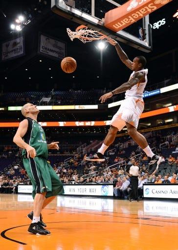 Oct 7, 2013; Phoenix, AZ, USA; Phoenix Suns guard Shannon Brown (26) dunks the ball in the second half over Haifa center Ido Kozikaro (13) at US Airways Center. The Suns defeated Haifa 130 to 89.  Mandatory Credit: Jennifer Stewart-USA TODAY Sports