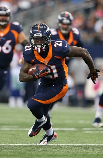 Oct 6, 2013; Arlington, TX, USA; Denver Broncos running back Ronnie Hillman (21) runs with the ball against the Dallas Cowboys at AT&T Stadium. Mandatory Credit: Matthew Emmons-USA TODAY Sports