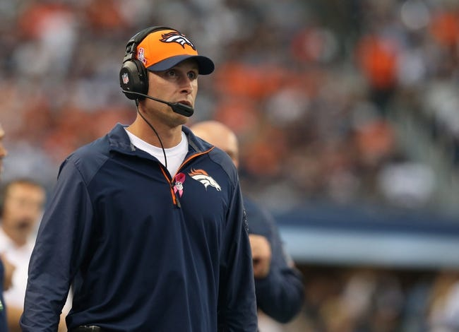 Oct 6, 2013; Arlington, TX, USA; Denver Broncos offensive coordinator Adam Gase on the sidelines against the Dallas Cowboys at AT&T Stadium. Mandatory Credit: Matthew Emmons-USA TODAY Sports