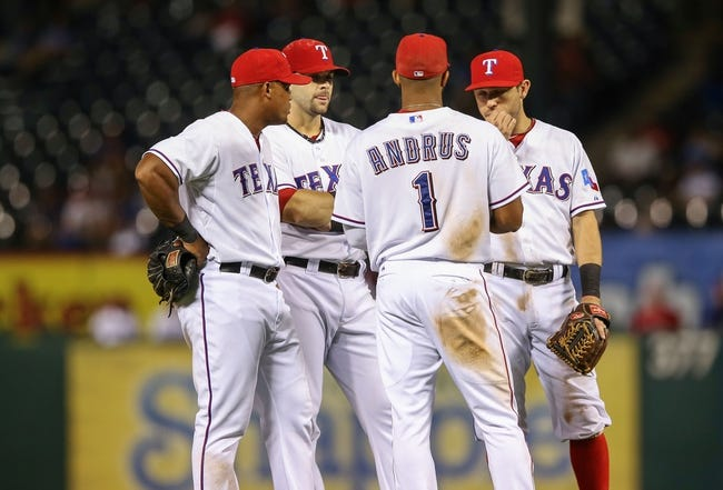 Sep 26, 2013; Arlington, TX, USA; Texas Rangers players Texas Rangers third baseman Adrian Beltre (far left) and  first baseman Mitch Moreland (18) and shortstop Elvis Andrus (1) and second baseman Ian Kinsler (far right) chat during the game against the Los Angeles Angels at Rangers Ballpark in Arlington. Mandatory Credit: Kevin Jairaj-USA TODAY Sports