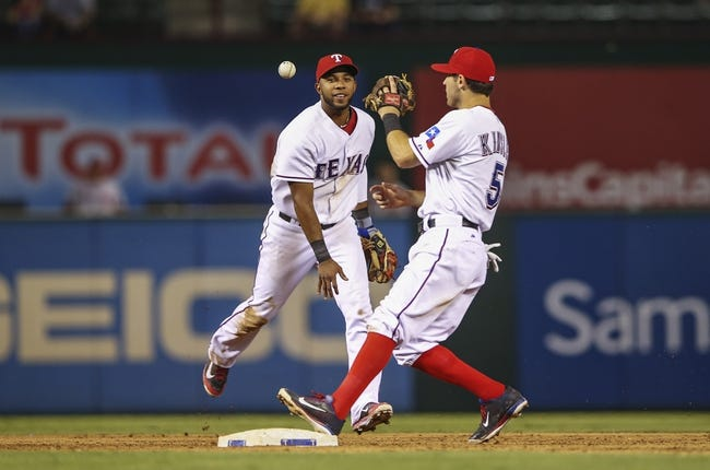 Sep 26, 2013; Arlington, TX, USA; Texas Rangers shortstop Elvis Andrus (1) throws the ball to second baseman Ian Kinsler (5) during the game against the Los Angeles Angels at Rangers Ballpark in Arlington. Mandatory Credit: Kevin Jairaj-USA TODAY Sports