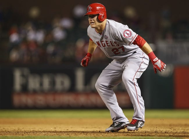 Sep 26, 2013; Arlington, TX, USA;  Los Angeles Angels center fielder Mike Trout (27) leads off during the game against the Texas Rangers at Rangers Ballpark in Arlington. Mandatory Credit: Kevin Jairaj-USA TODAY Sports
