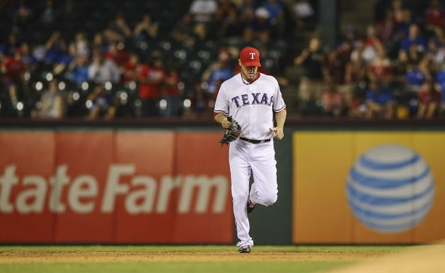 Sep 26, 2013; Arlington, TX, USA; Texas Rangers relief pitcher Joe Nathan (36) enters the game during the ninth inning against the Los Angeles Angels at Rangers Ballpark in Arlington. Mandatory Credit: Kevin Jairaj-USA TODAY Sports