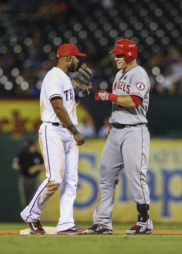 Sep 26, 2013; Arlington, TX, USA; Texas Rangers shortstop Elvis Andrus (1) laughs with Los Angeles Angels center fielder Mike Trout (27) during the game at Rangers Ballpark in Arlington. Mandatory Credit: Kevin Jairaj-USA TODAY Sports