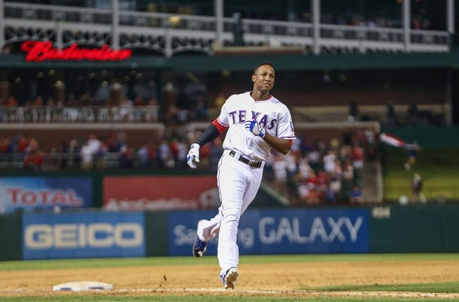 Sep 26, 2013; Arlington, TX, USA; Texas Rangers second baseman Jurickson Profar (13) rounds the bases after hitting a home run during the game against the Los Angeles Angels at Rangers Ballpark in Arlington. Mandatory Credit: Kevin Jairaj-USA TODAY Sports