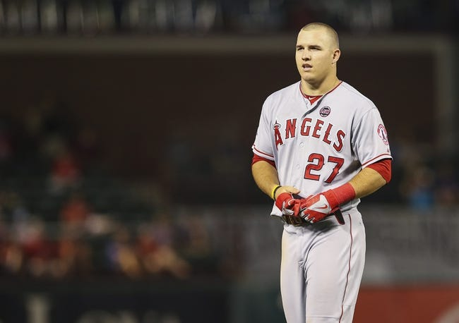 Sep 26, 2013; Arlington, TX, USA;  Los Angeles Angels center fielder Mike Trout (27) reacts during the game against the Texas Rangers at Rangers Ballpark in Arlington. Mandatory Credit: Kevin Jairaj-USA TODAY Sports