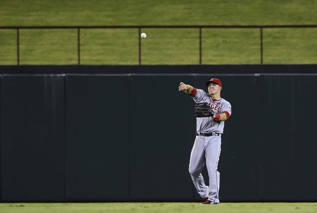 Sep 26, 2013; Arlington, TX, USA;  Los Angeles Angels center fielder Mike Trout (27) fields a ball during the game against the Texas Rangers at Rangers Ballpark in Arlington. Mandatory Credit: Kevin Jairaj-USA TODAY Sports